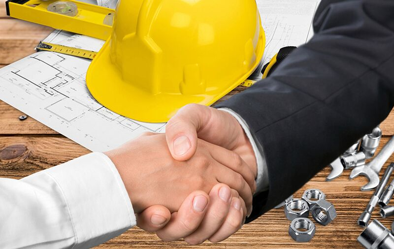 contractor and homeowner shaking hands over a contract