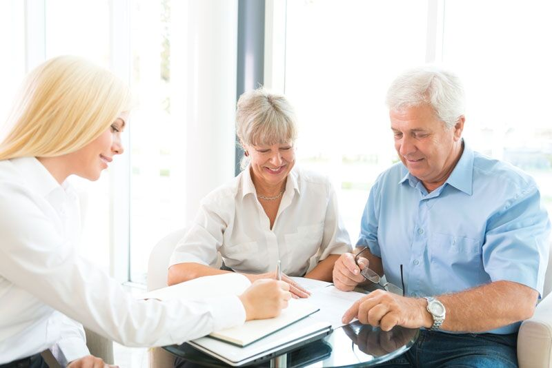 older couple reviewing their home policy with their agent