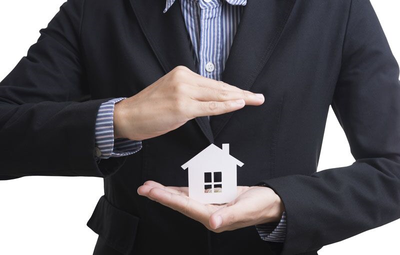 home cutout protected by hands