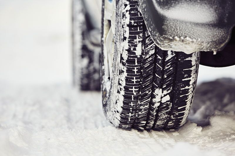 snow covered car tire