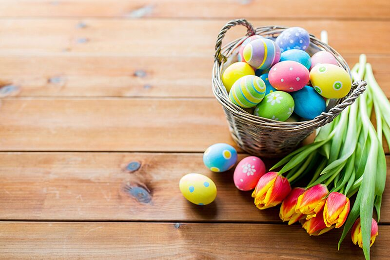 Easter basket, eggs, and flowers